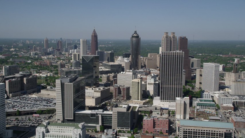 5K aerial video approaching Downtown Atlanta from Midtown skyscrapers, Georgia Aerial Stock Footage | AX37_012