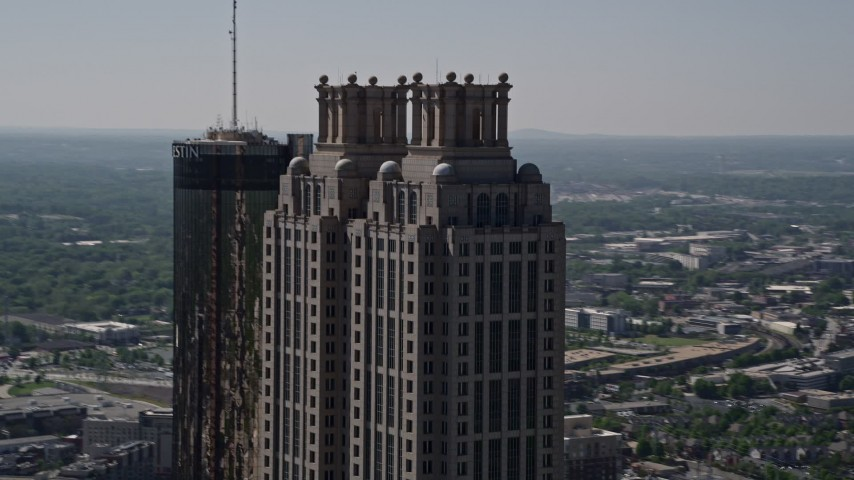 5K aerial video orbiting the top of 191 Peachtree Tower, Downtown Atlanta Aerial Stock Footage | AX37_015
