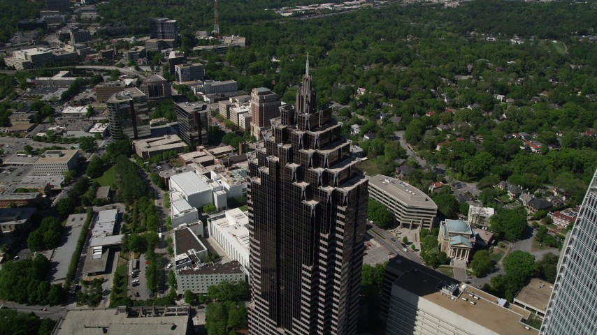 5K stock footage aerial video flying over GLG Grand to Promenade II, tilt down, Midtown Atlanta, Georgia Aerial Stock Footage | AX37_021