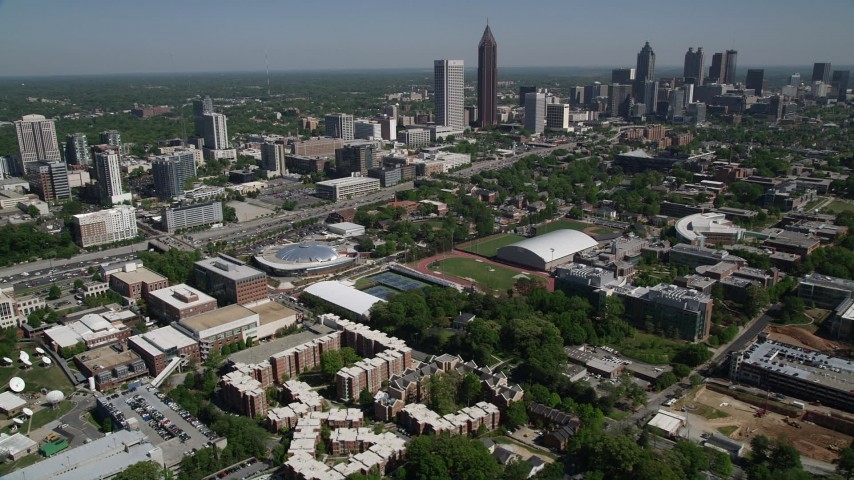 5K stock footage aerial video flying by Georgia Institute of Technology toward Midtown Atlanta skyscrapers, Atlanta, Georgia Aerial Stock Footage | AX37_034