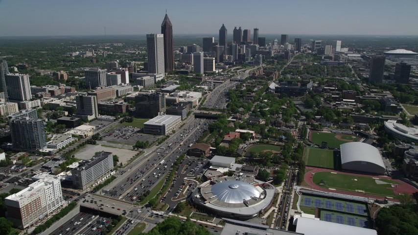 5K aerial video following the Downtown Connector toward Midtown Atlanta sksycrapers, Georgia Aerial Stock Footage | AX37_035
