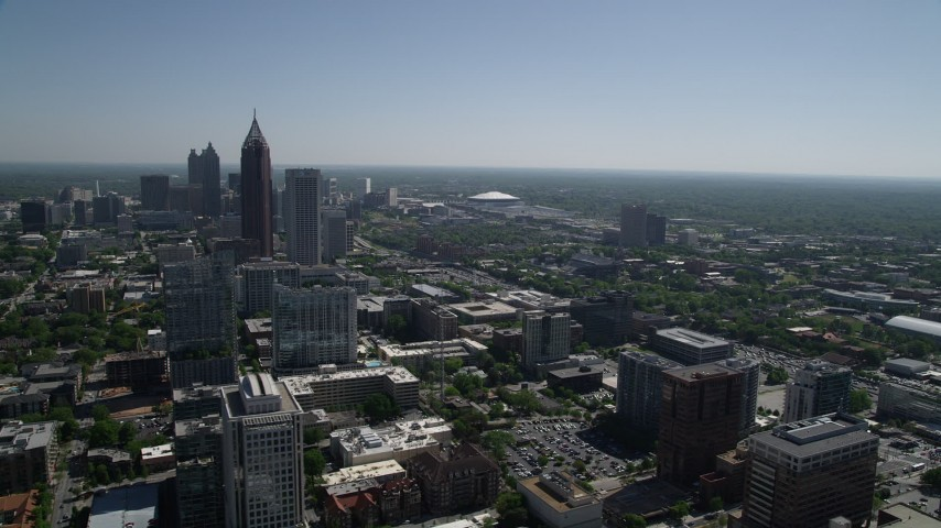 5K stock footage aerial video flying by Midtown Atlanta skyscrapers revealing Downtown, Georgia Aerial Stock Footage | AX37_037
