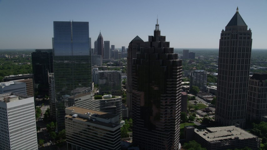 5K aerial video of a medium shot flying by Midtown Atlanta skyscrapers, Georgia Aerial Stock Footage | AX37_040