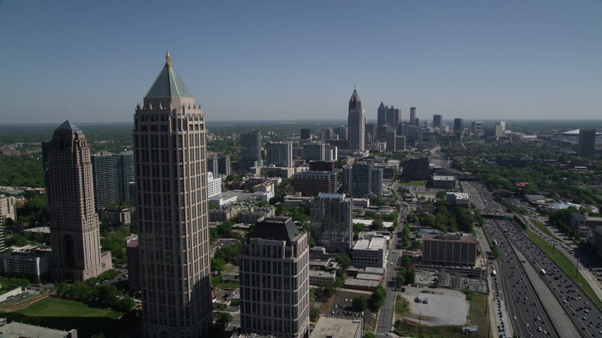 5K stock footage aerial video of Midtown Atlanta skyscrapers and office buildings along Downtown Connector, Georgia Aerial Stock Footage | AX37_041