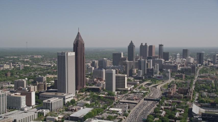 5K stock footage aerial video flying by Midtown Atlanta skyscrapers toward Downtown skyscrapers, Georgia Aerial Stock Footage | AX37_042
