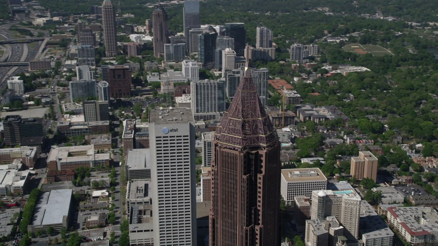 5K aerial video orbiting Bank of America Plaza revealing Georgia Tech campus, Atlanta, Georgia Aerial Stock Footage AX37_045