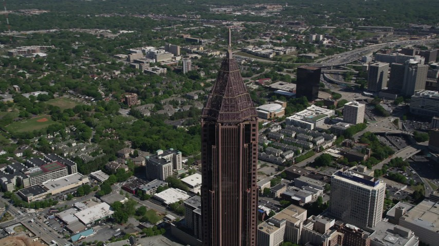 5K stock footage aerial video of the top of Bank of America Plaza revealing wooded area, Midtown Atlanta, Georgia Aerial Stock Footage AX37_048 | Axiom Images