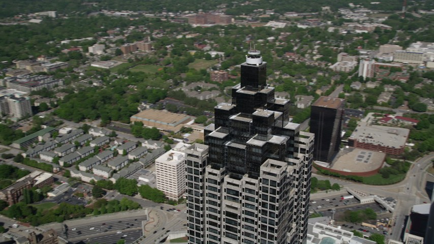 5K stock footage aerial video of a medium shot orbiting the top of SunTrust Plaza revealing, Downtown Atlanta Aerial Stock Footage | AX37_050