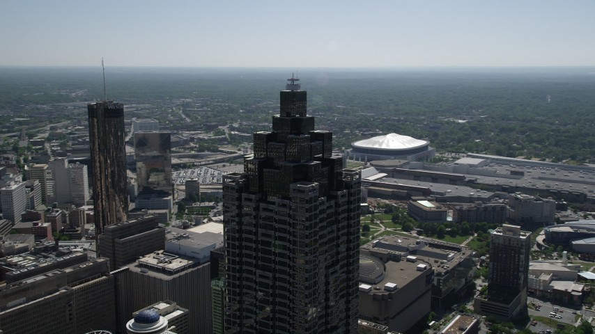 5K stock footage aerial video orbiting SunTrust Plaza revealing Downtown Atlanta, Georgia Aerial Stock Footage AX37_052 | Axiom Images