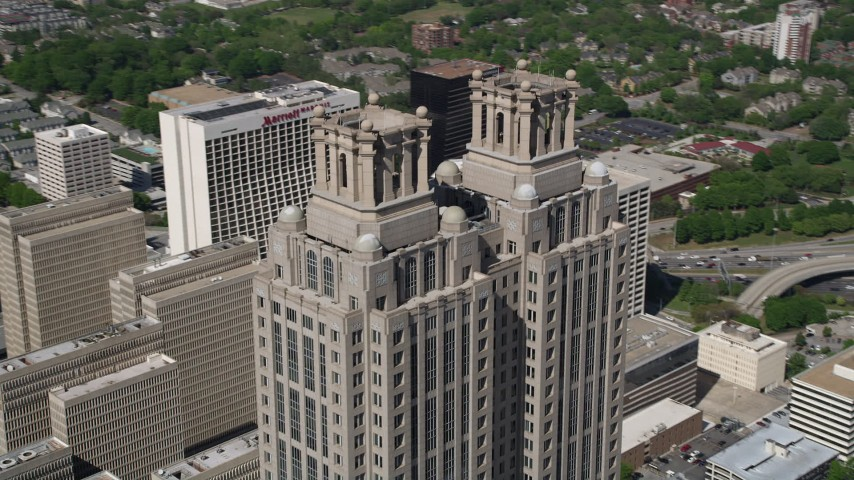 5K stock footage aerial video orbiting 191 Peachtree Tower, revealing Westin Peachtree Plaza, Downtown Atlanta Aerial Stock Footage | AX37_054