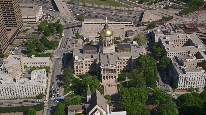 5K aerial video tilting down to bird's eye of Georgia State Capitol, Downtown Atlanta Aerial Stock Footage | AX37_060