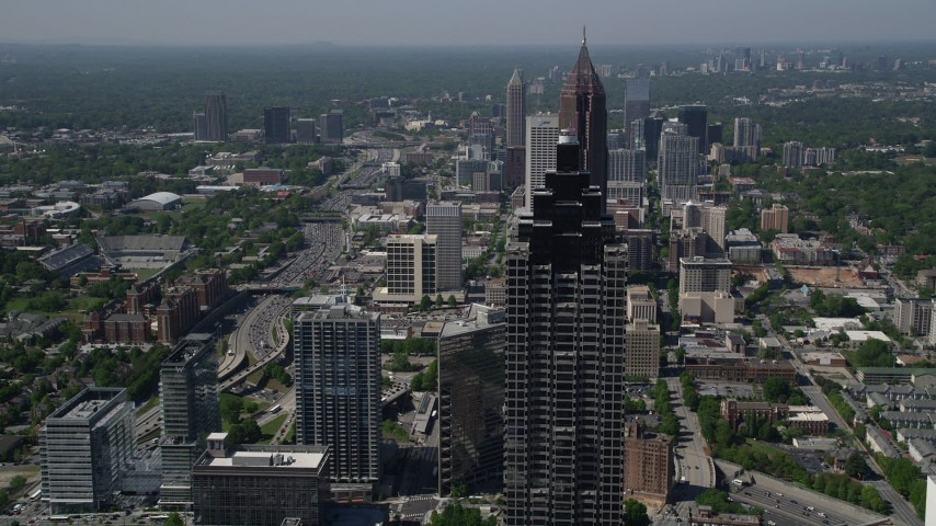 5K stock footage aerial video flying over Midtown Atlanta skyscrapers, Georgia Aerial Stock Footage | AX37_067
