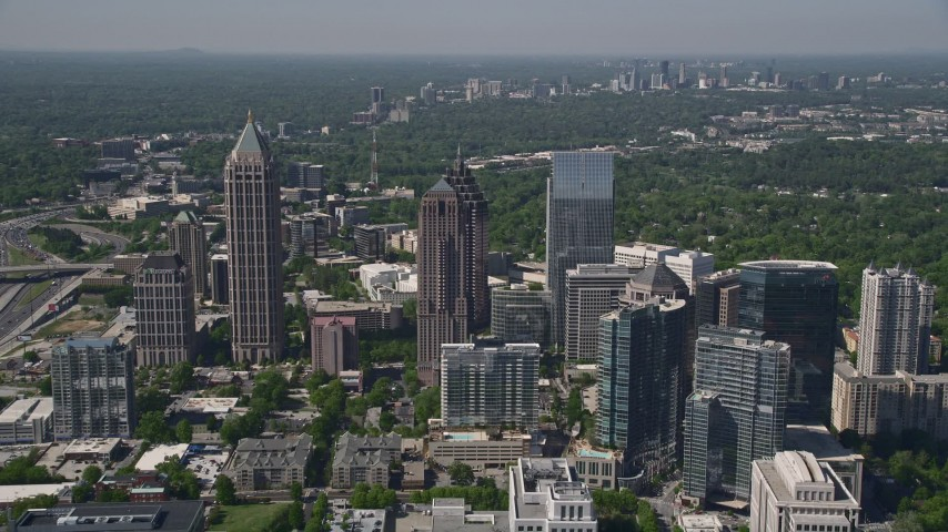 5K stock footage aerial video flying by Midtown Atlanta skyscrapers, Georgia Aerial Stock Footage | AX37_069