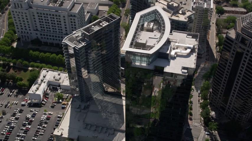 5K stock footage aerial video flying by Loews Atlanta Hotel, Midtown Atlanta, Georgia Aerial Stock Footage | AX37_070