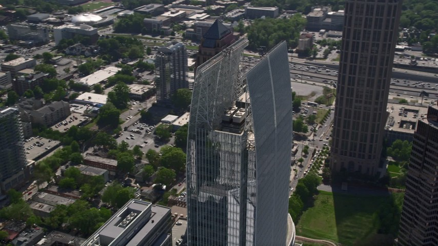 5K stock footage aerial video orbiting 1180 Peachtree among Midtown Atlanta skyscrapers, Georgia Aerial Stock Footage | AX37_071