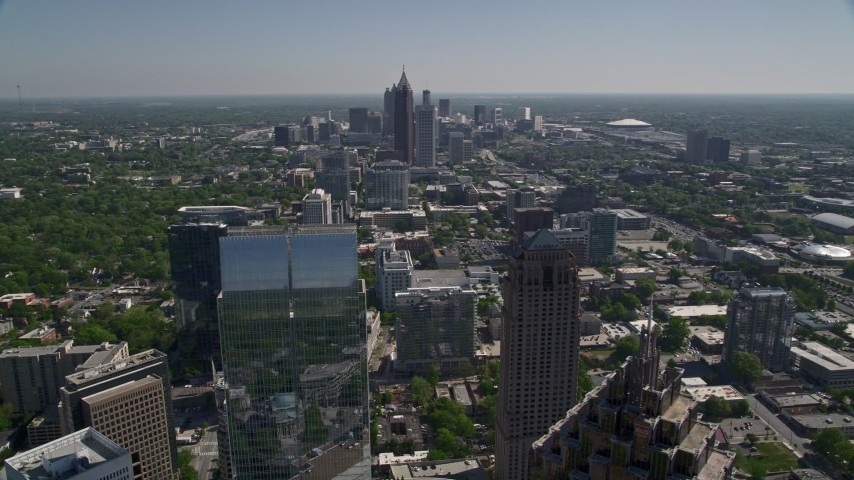 5K stock footage aerial video flying by Midtown Atlanta skyscrapers revealing One Atlantic Center, Georgia Aerial Stock Footage | AX37_072
