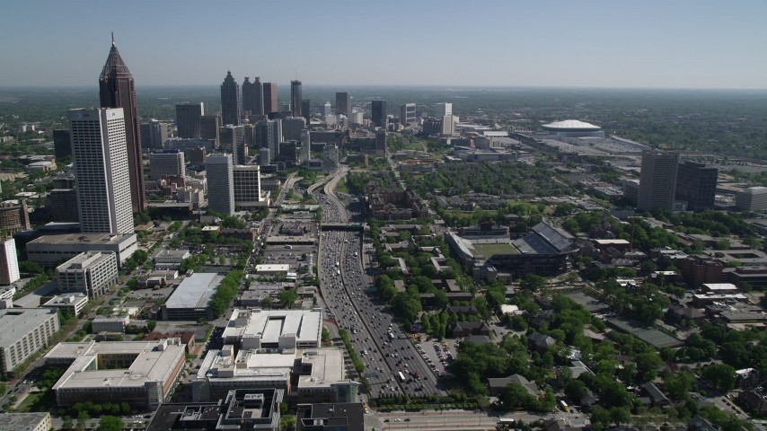 5K aerial video following heavy traffic on Downtown Connector toward Downtown Atlanta Aerial Stock Footage | AX37_073