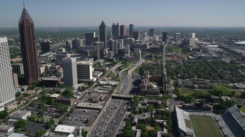 5K stock footage aerial video tracking heavy traffic on Downtown Connector, Midtown Atlanta, Georgia Aerial Stock Footage | AX37_074