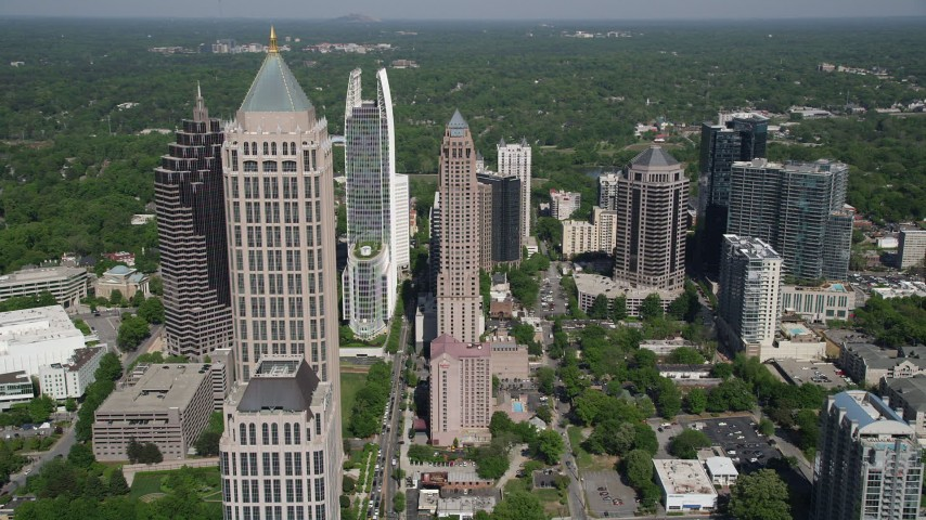 5K aerial video flying by Midtown Atlanta skyscrapers, Georgia Aerial Stock Footage | AX37_082