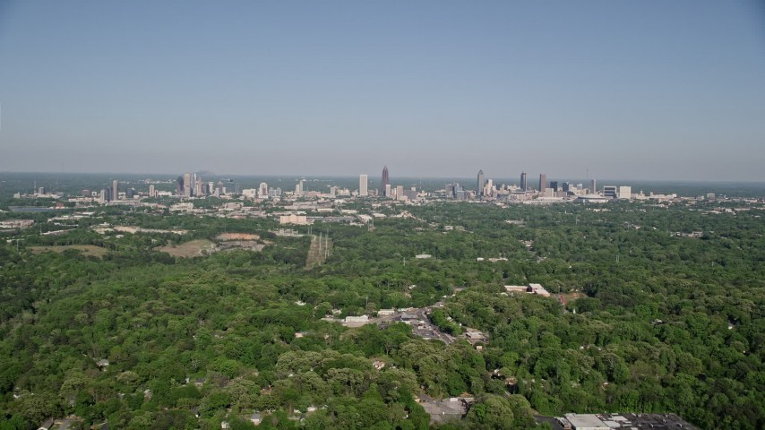 5K stock footage aerial video flying over forests toward Midtown and Downtown Atlanta, Georgia Aerial Stock Footage | AX38_003