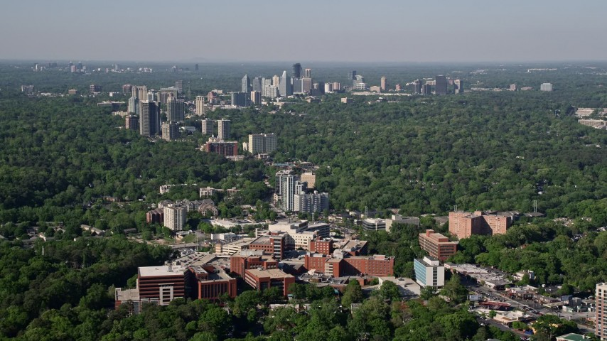 5K aerial video of a wide shot of skyscrapers and high-rises surrounded by forests, Buckhead, Georgia Aerial Stock Footage | AX38_007
