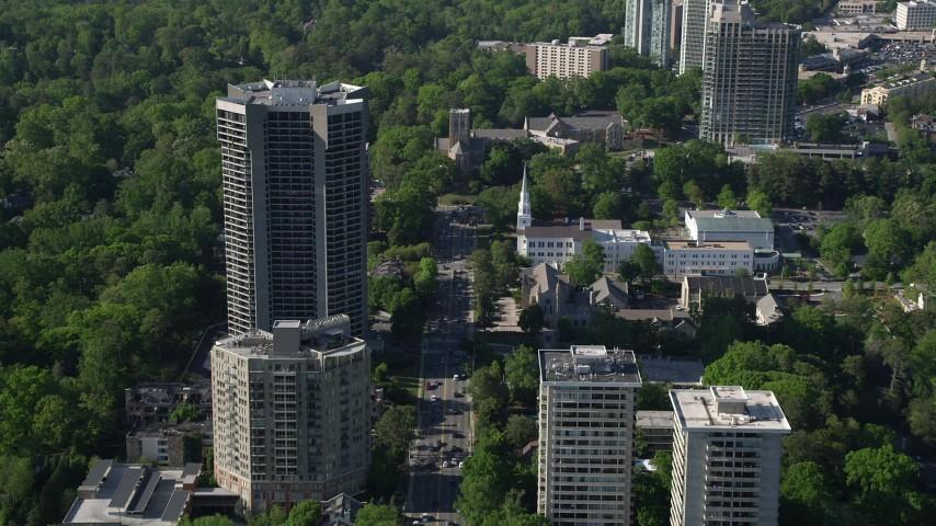 5K stock footage aerial video approaching a church near condominium complexes, Buckhead, Georgia Aerial Stock Footage | AX38_010