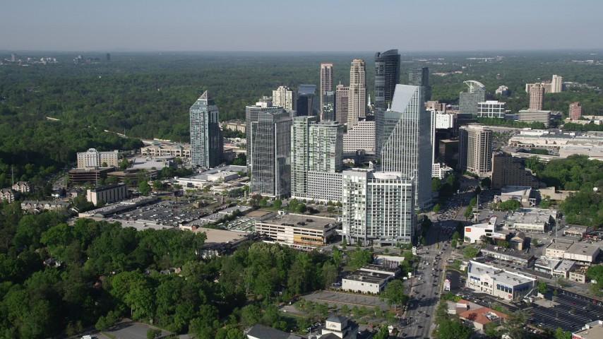 5K aerial video approaching skyscrapers and Terminus Atlanta, Buckhead, Georgia Aerial Stock Footage | AX38_013