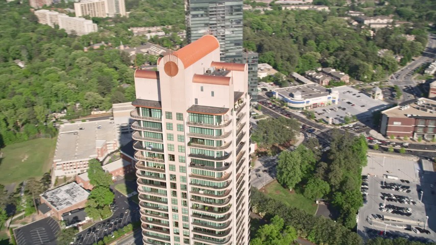 5K stock footage aerial video of a medium shot of Park Avenue Condos revealing skyscrapers, Buckhead, Georgia Aerial Stock Footage | AX38_024