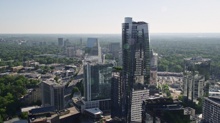 5K stock footage aerial video flying by 3344 Peachtree skyscraper and approach Terminus Atlanta, Buckhead, Georgia Aerial Stock Footage | AX38_026