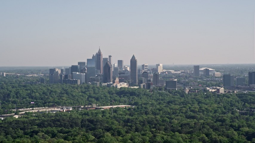 5K aerial video of Midtown Atlanta skyscrapers  beyond trees, Buckhead, Georgia Aerial Stock Footage | AX38_028