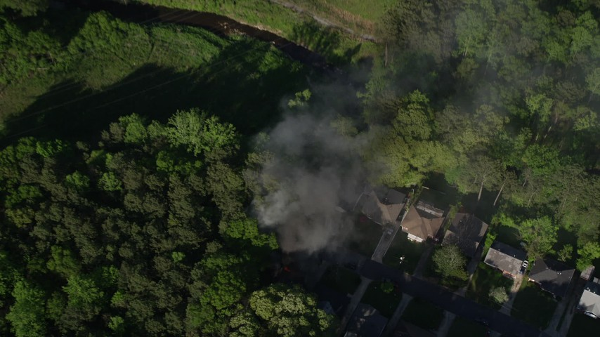 5K stock footage aerial video tilting down to a bird's eye of smoke rising from a home, West Atlanta Aerial Stock Footage AX38_035 | Axiom Images