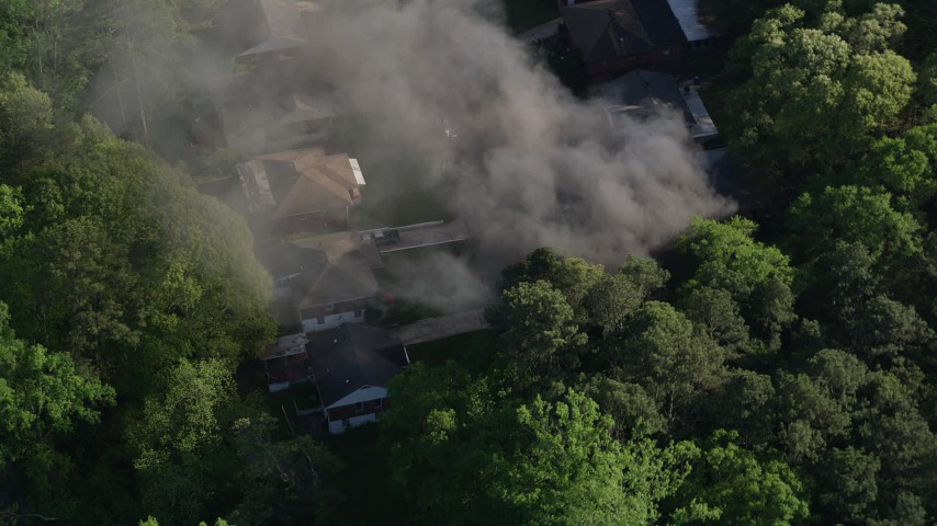 5K stock footage aerial video orbiting smoke from a burning home, West Atlanta, Georgia Aerial Stock Footage | AX38_038