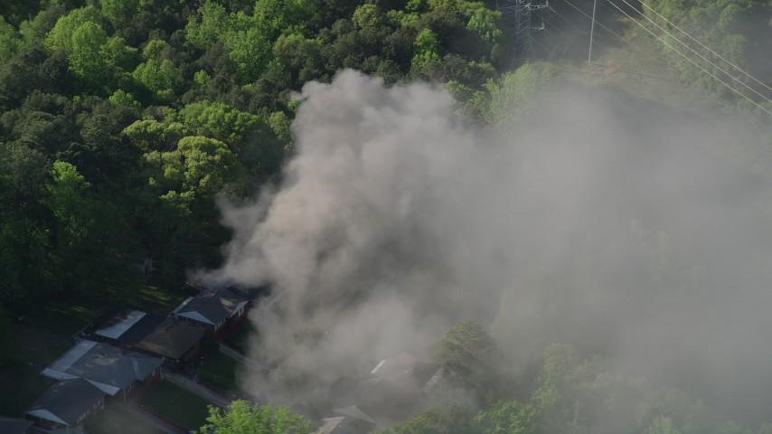 5K aerial video orbiting smoke from a burning home, West Atlanta, Georgia Aerial Stock Footage | AX38_039