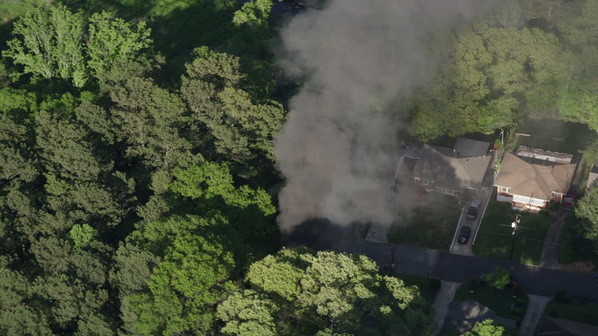 5K stock footage aerial video orbiting black smoke from a burning home, West Atlanta, Georgia Aerial Stock Footage | AX38_040