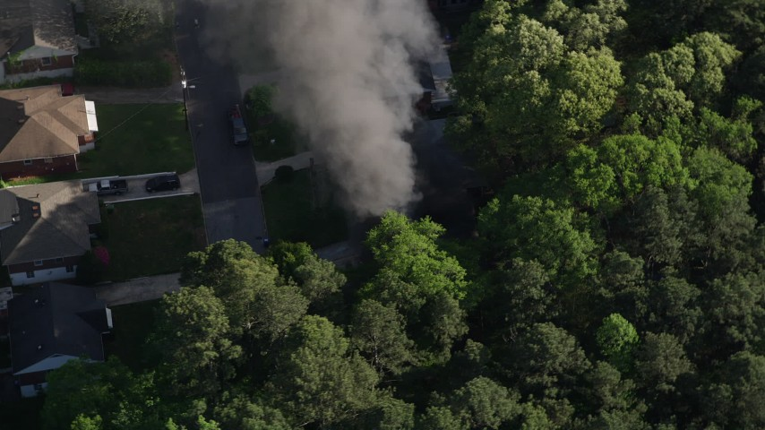5K stock footage aerial video circling above a home on fire, West Atlanta, Georgia Aerial Stock Footage | AX38_041