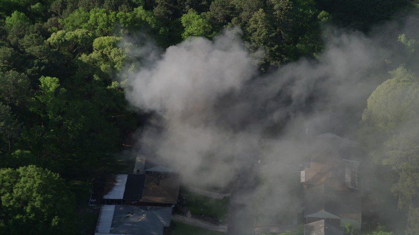 5K aerial video of smoke rising from a burning home, West Atlanta, Georgia Aerial Stock Footage | AX38_043