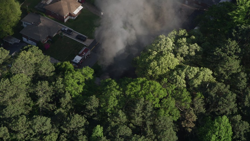 5K stock footage aerial video circling above rising smoke from a house fire, West Atlanta, Georgia Aerial Stock Footage AX38_044 | Axiom Images