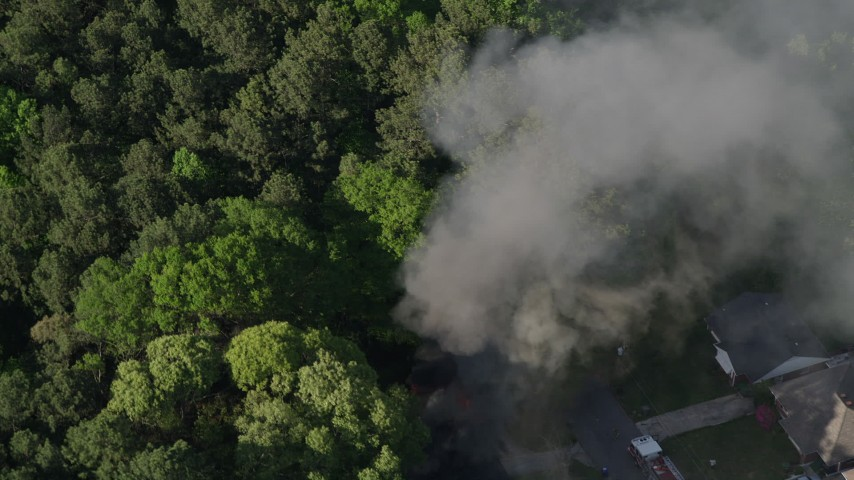 5K stock footage aerial video circling a house fire and rising smoke, West Atlanta, Georgia Aerial Stock Footage | AX38_046