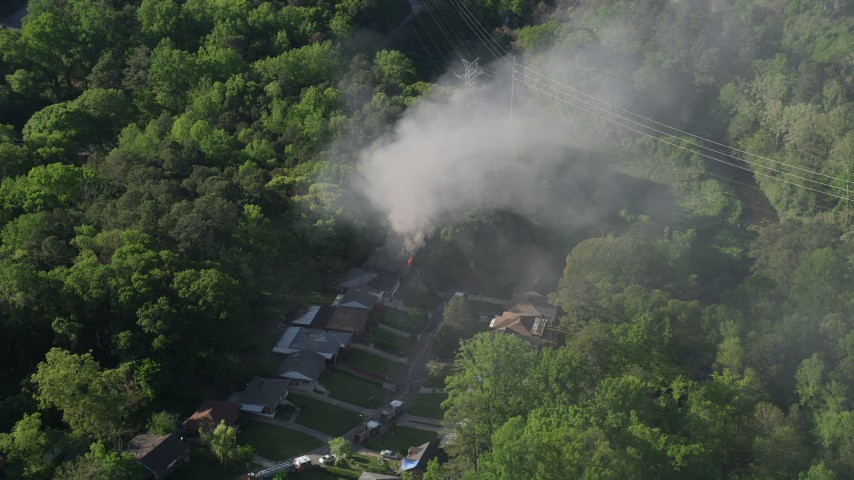 5K stock footage aerial video of smoke rising from a burning home, West Atlanta, Georgia Aerial Stock Footage | AX38_050