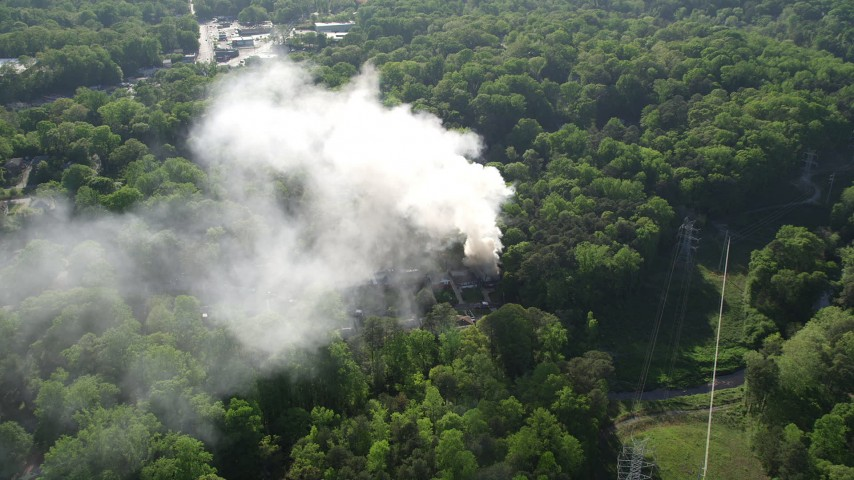 5K stock footage aerial video approaching rising smoke from a burning house, West Atlanta, Georgia Aerial Stock Footage | AX38_055