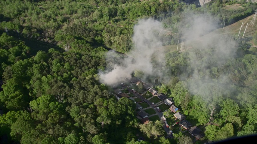 5K stock footage aerial video of smoke rising from a house fire in a wooded area, West Atlanta Aerial Stock Footage | AX38_057