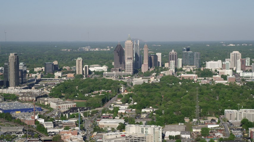 5K aerial video approaching Midtown Atlanta skyscrapers, Georgia Aerial Stock Footage | AX38_059