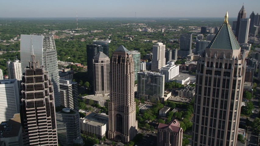 5K aerial video of a medium shot of skyscrapers revealing more skyscrapers in the distance, Midtown Atlanta Aerial Stock Footage | AX38_067