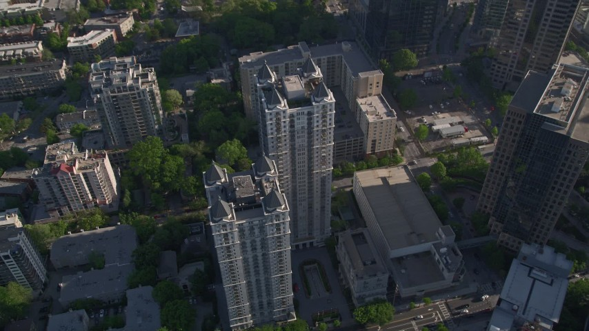 5K stock footage aerial video tilting down to bird's eye of condominium complex, Midtown Atlanta Aerial Stock Footage | AX38_068