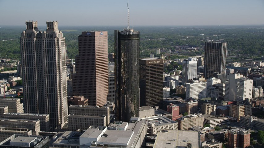 5K aerial video approaching skyscrapers and Westin, Downtown Atlanta Aerial Stock Footage | AX38_072