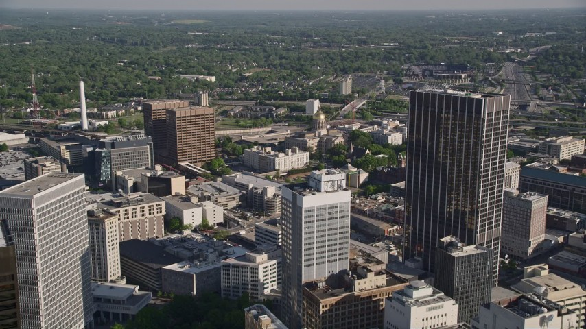 5K stock footage aerial video approaching Georgia State Capitol among office buildings, Downtown Atlanta Aerial Stock Footage | AX38_073