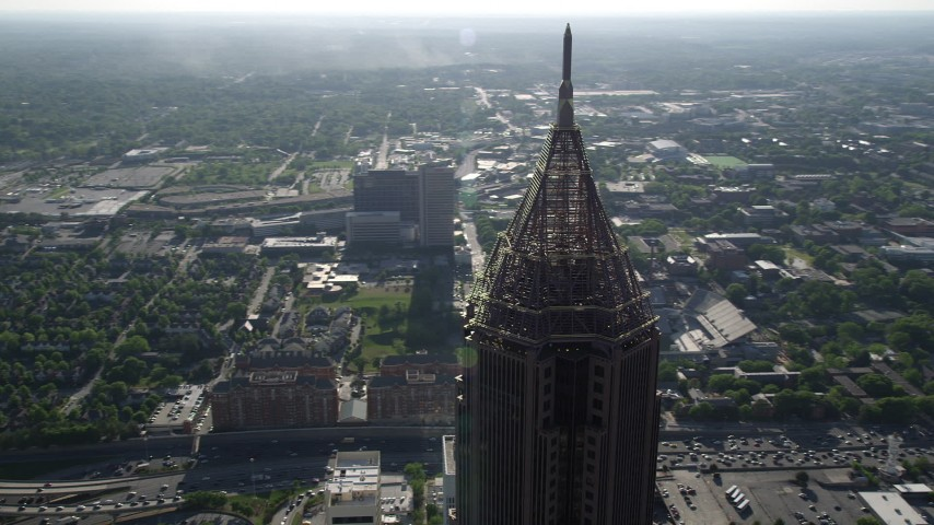 5K aerial video of a medium shot of the top of Bank of America Plaza, Midtown Atlanta Aerial Stock Footage AX38_077