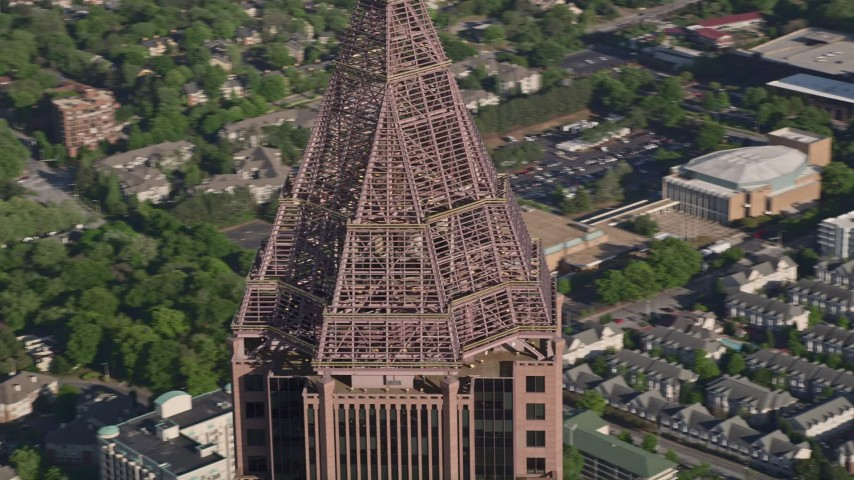 5K stock footage aerial video close-up orbiting the top of Bank of America Plaza, Midtown Atlanta Aerial Stock Footage | AX38_078