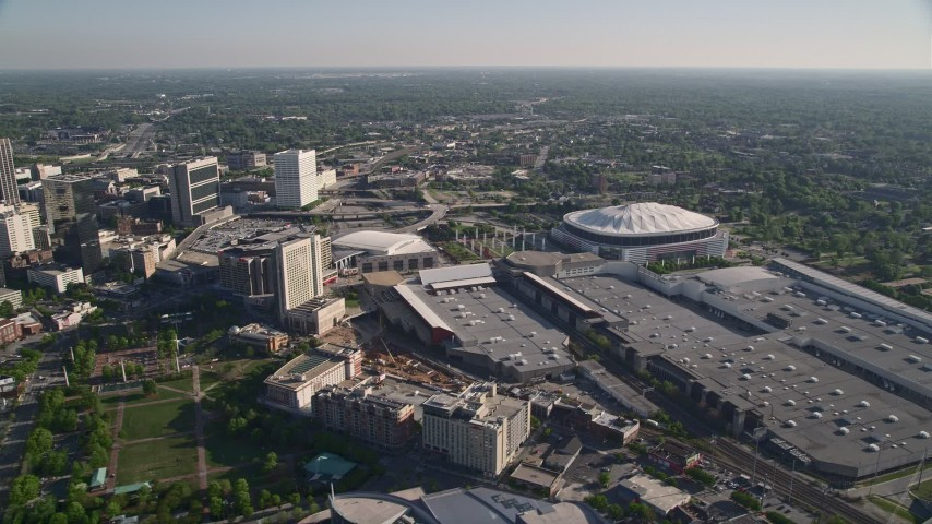 5K stock footage aerial video approaching Georgia Dome and Georgia World Congress Center, Atlanta Aerial Stock Footage | AX38_080