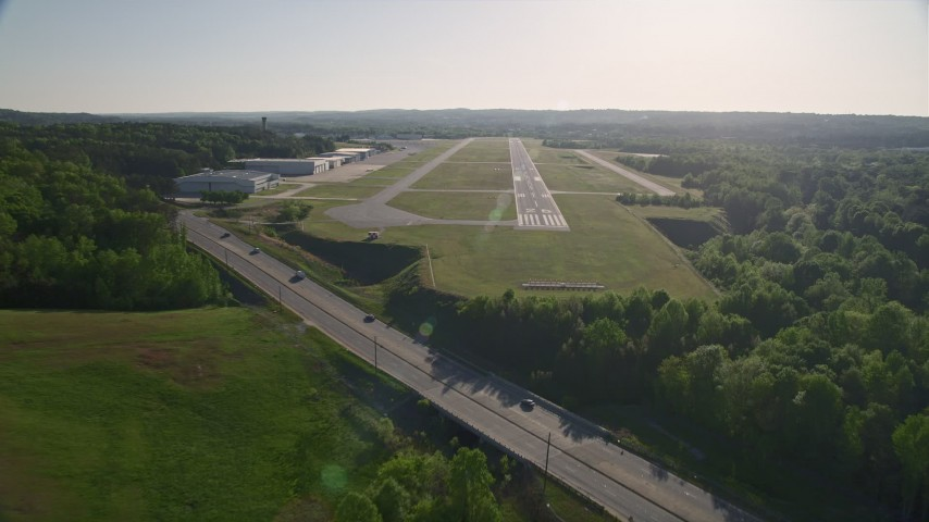 5K stock footage aerial video approaching a runway, Fulton County Airport, Georgia Aerial Stock Footage | AX38_085